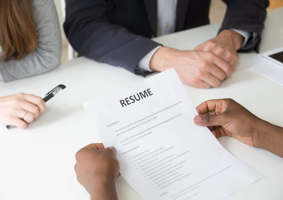 African american applicant holding curriculum vitae at interview, black unemployed job seeker giving hr cv at hiring negotiations, employment and recruiting concept, focus on resume, close up view